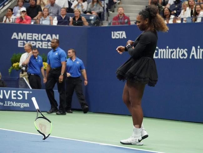 Serena Williams's racket bends from the force of the throw. Picture: Timothy Clary/AFP