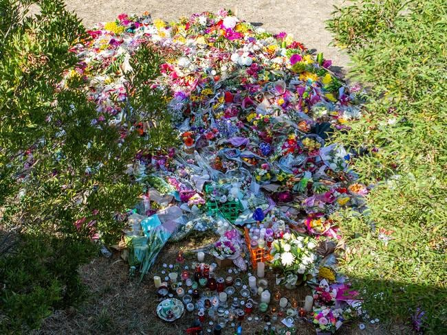Mass of floral tributes where the body of Aiia Maasarwe was found in Bundoora. Picture: Sarah Matray.