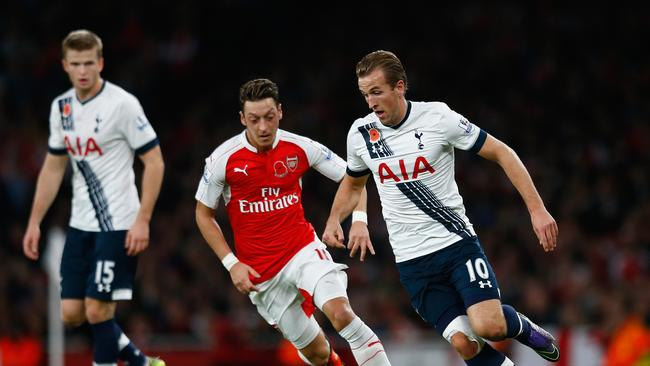 Harry Kane of Spurs takes on Mesut Oezil of Arsenal
