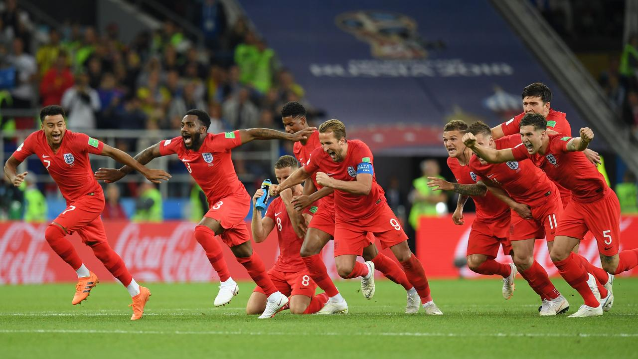 The England players celebrate after Eric Dier of England scores the winning penalty against Colombia in the quarterfinal.