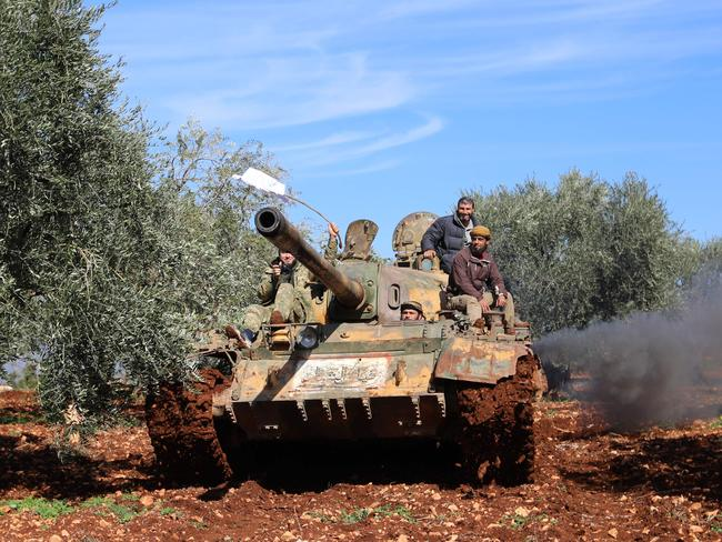 Turkish-backed Syrian rebel fighters are seen in the town of Salwah, less than 10 kilometres from the Syria-Turkey border, ahead of firing towards Kurdish forces from the People's Protection Units (YPG). Picture: AFP