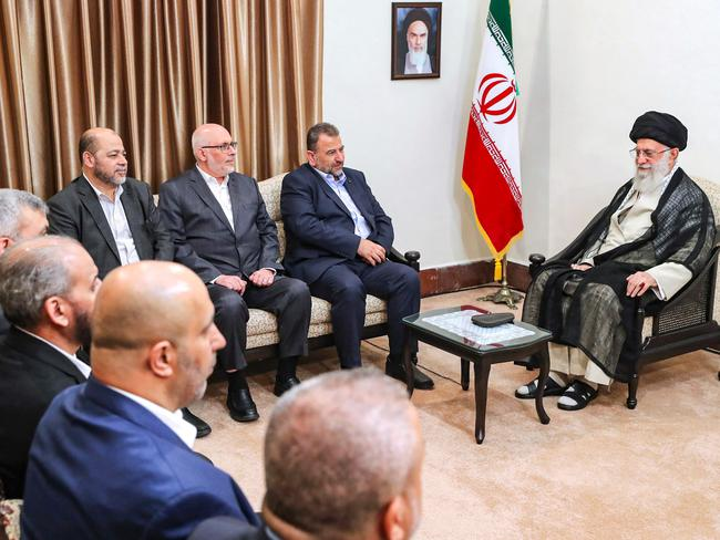 Iran's Supreme Leader Ayatollah Ali Khamenei (R) meeting with Hamas' Deputy Chief Saleh al-Arouri and other members from the Hamas delegation in the capital Tehran. Picture: AFP