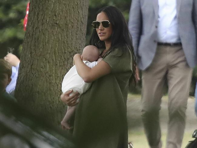 Trolls have again attacked Meghan over the way she held her son Archie at a polo event in the UK. Picture: AP