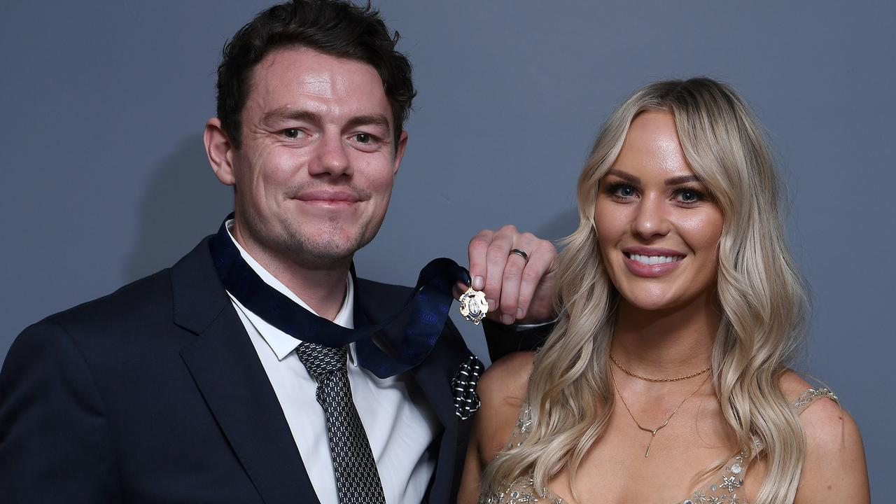 Winner Lachie Neale poses with his wife Julie.