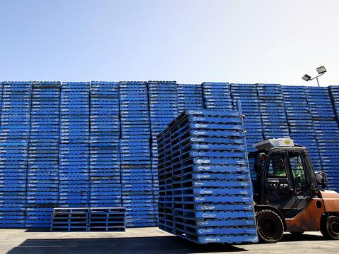 A worker uses a forklift to stack Brambles Ltd.'s CHEP pallets at CHEP's Dandenong South Service Centre outside Melbourne, Australia, on Monday, Aug. 17, 2009. Brambles Ltd., the world's biggest supplier of pallets used to move and store goods in factories, will announce full-year earnings on Aug. 20, 2009. Photographer: Luis Enrique Ascui/Bloomberg