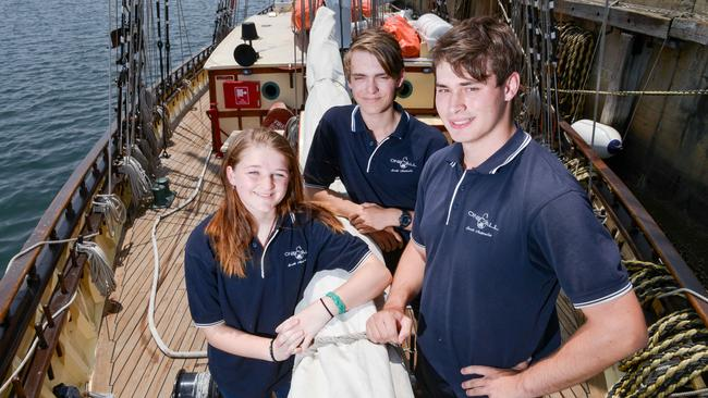 Amber Finn, pictured with Stuart Mesecke and Aleks Cameron, says the cadetships are an awesome opportunity for other young people. Picture: AAP / Brenton Edwards