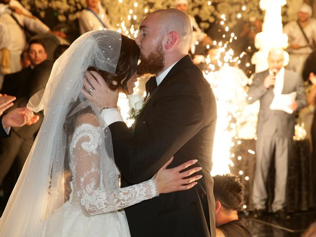 Salim Mehajer's sister Kat and her new husband Ibraham making their entrance to their wedding reception held at Doltone House, Hyde Park. Picture: Jonathan Ng