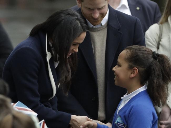 School girl Sophia Richards greets Meghan Markle on the street. Photo: AP / Matt Dunham
