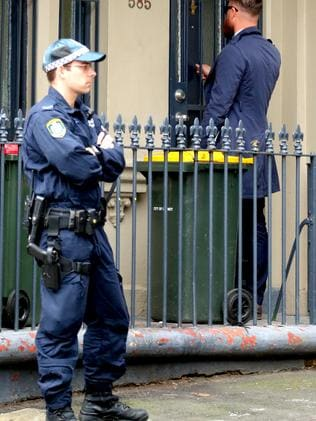 Detectives doorknock the Surry Hills area as part of the ongoing investigation. Picture: John Grainger