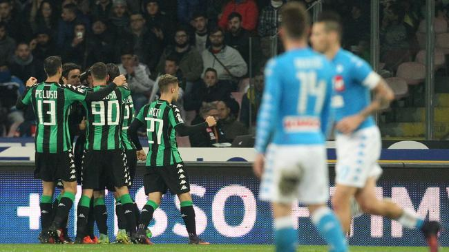 Sassuolo's players celebrate after scoring.