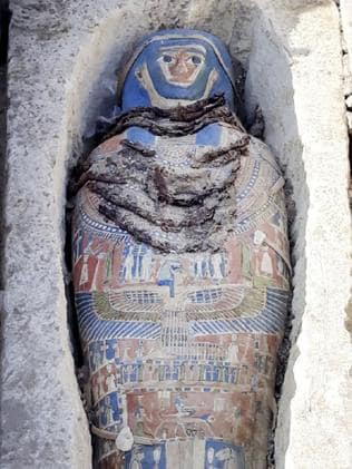 An ancient mummy covered with a layer of painted cartonnage. Picture: Egyptian Ministry of Antiquities