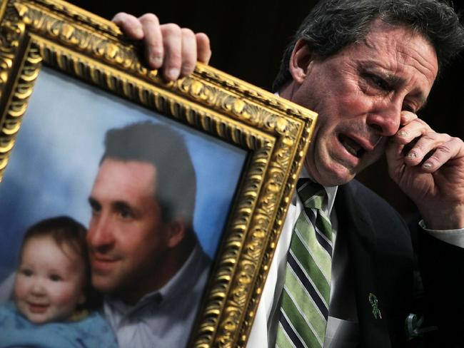 Neil Heslin, father of six-year-old Sandy Hook Elementary School shooting victim Jesse Lewis, wipes tears. Picture: Getty