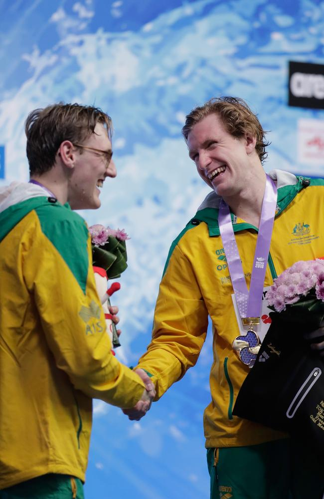 Silver medallist Mack Horton and gold medallist Jack McLoughlin shake hands on the podium at the medal ceremony for the men's 400m freestyle.