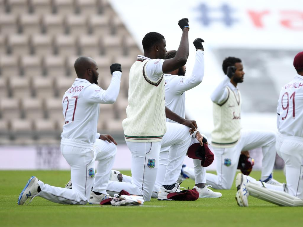 West Indies captain Jason Holder and his teammates take a knee.