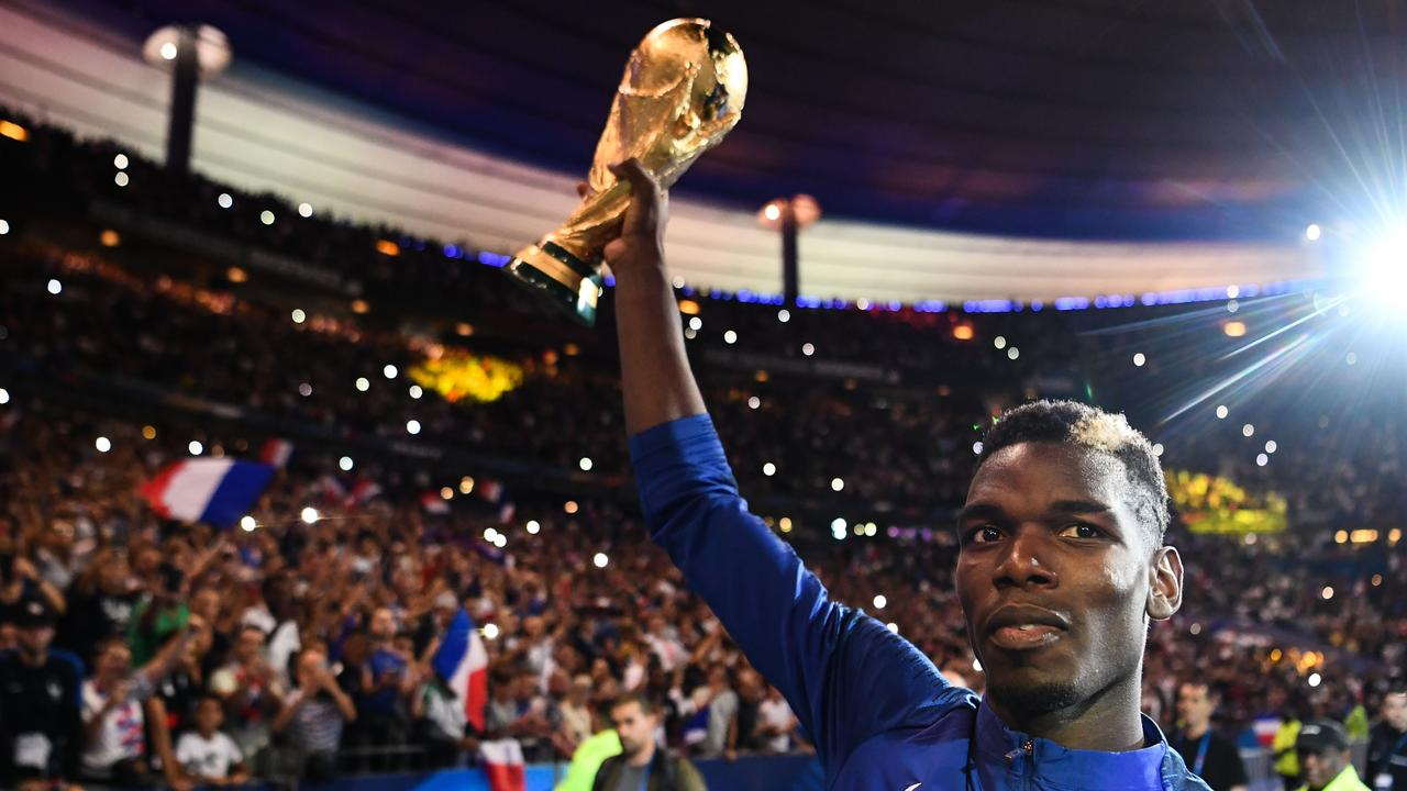 France's midfielder Paul Pogba holds the 2018 World Cup trophy