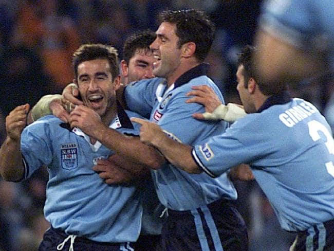 Andrew Johns (L) is congratulated by Brad Fittler after scoring a try during their playing days.