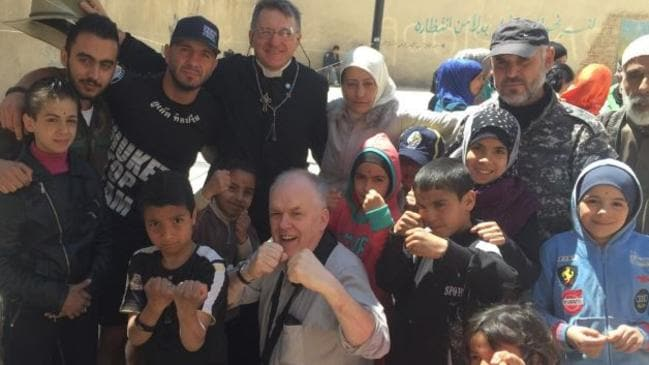 A former pro boxer, Father David Smith has for years taught boxing to troubled youth in Sydney, Australia. His boxing lessons on his Syrian humanitarian missions have proved enormously popular.