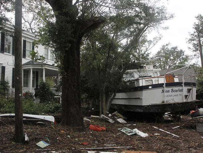 A boat rests in front of a damaged home from tropical storm Florence in New Bern, N.C. Picture: AP