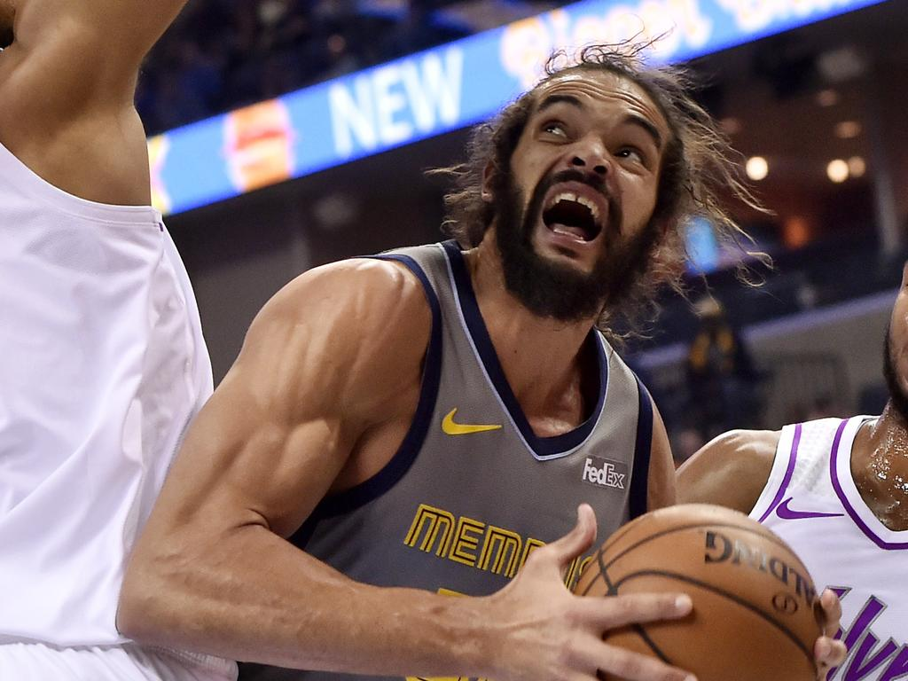 FILE - In this March 23, 2019, file photo, then-Memphis Grizzlies center Joakim Noah, center, looks to shoot between Minnesota Timberwolves center Karl-Anthony Towns (32) and guard Josh Okogie, right, in the first half of an NBA basketball game in Memphis, Tenn. The Clippers signed free-agent center Joakim Noah, giving them an aggressive, physical presence with playoff experience. (AP Photo/Brandon Dill, File)