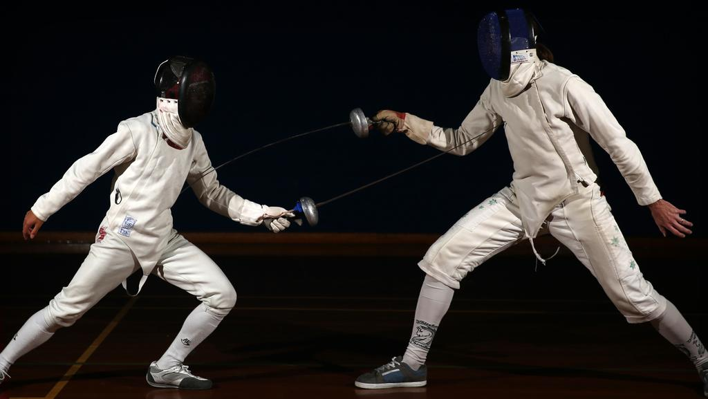 Whitehorse Chevaliers Fencing Club's Connor Mai and David Cook at training last week. Picture: Brendan Francis