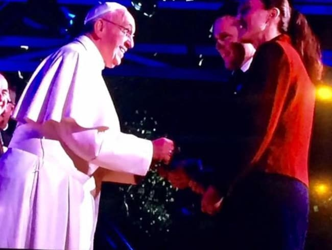 Life changing ... the couple are greeted by Pope Francis after their speech.