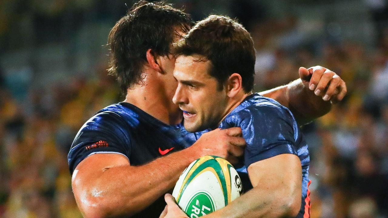 Argentina's Nicolas Sanchez is embraced by Pablo Matera after scoring a try.