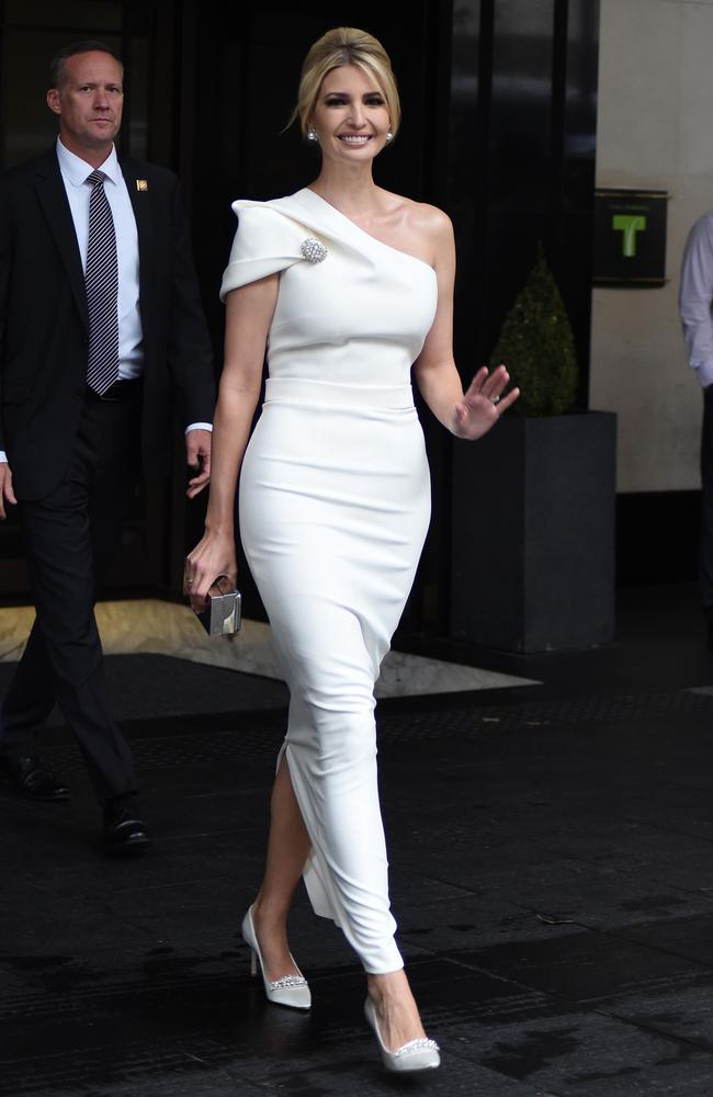 Ivanka Trump makes a 'stunning' comeback, wearing an off-shoulder white gown, during a visit to the UK after she was slammed earlier for wearing a 'shirt dress'. Picture: Splash New
