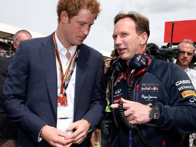 Prince Harry speaks with Red Bull Team Principal Christian Horner on the grid before the British GP.