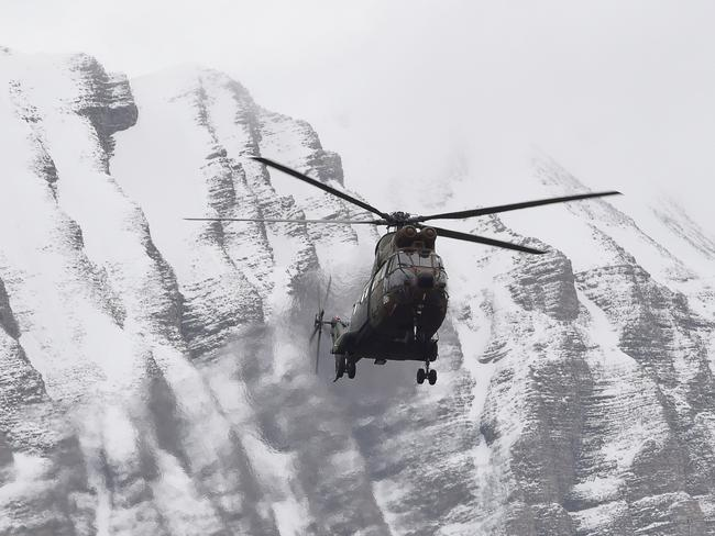 A helicopter flies near Seyne, near the site where the Germanwings Airbus A320 crashed. Picture: Boris Horvat