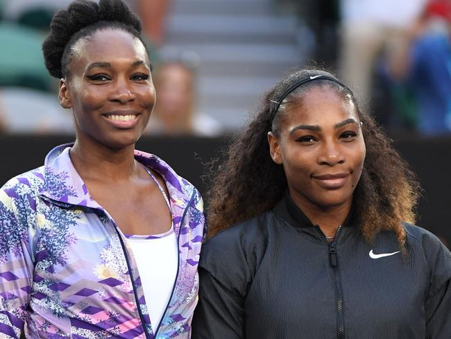Venus and Serena Williams are on track for an early match-up.