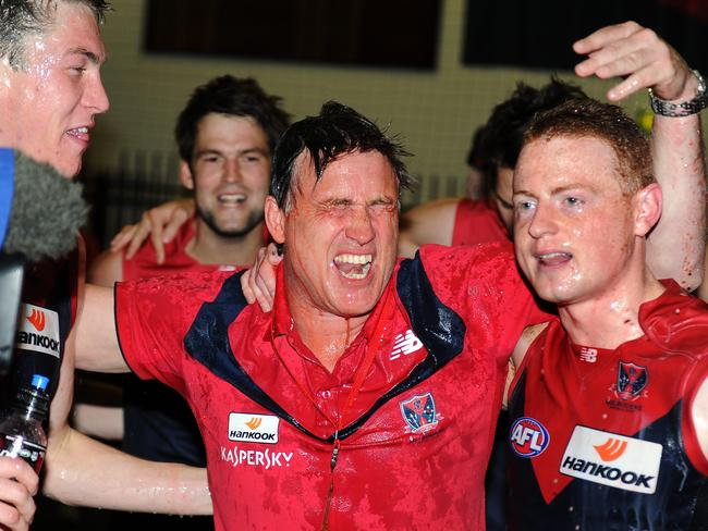 Todd Viney with Tom McDonald and Sam Blease after a rare win in 2011.