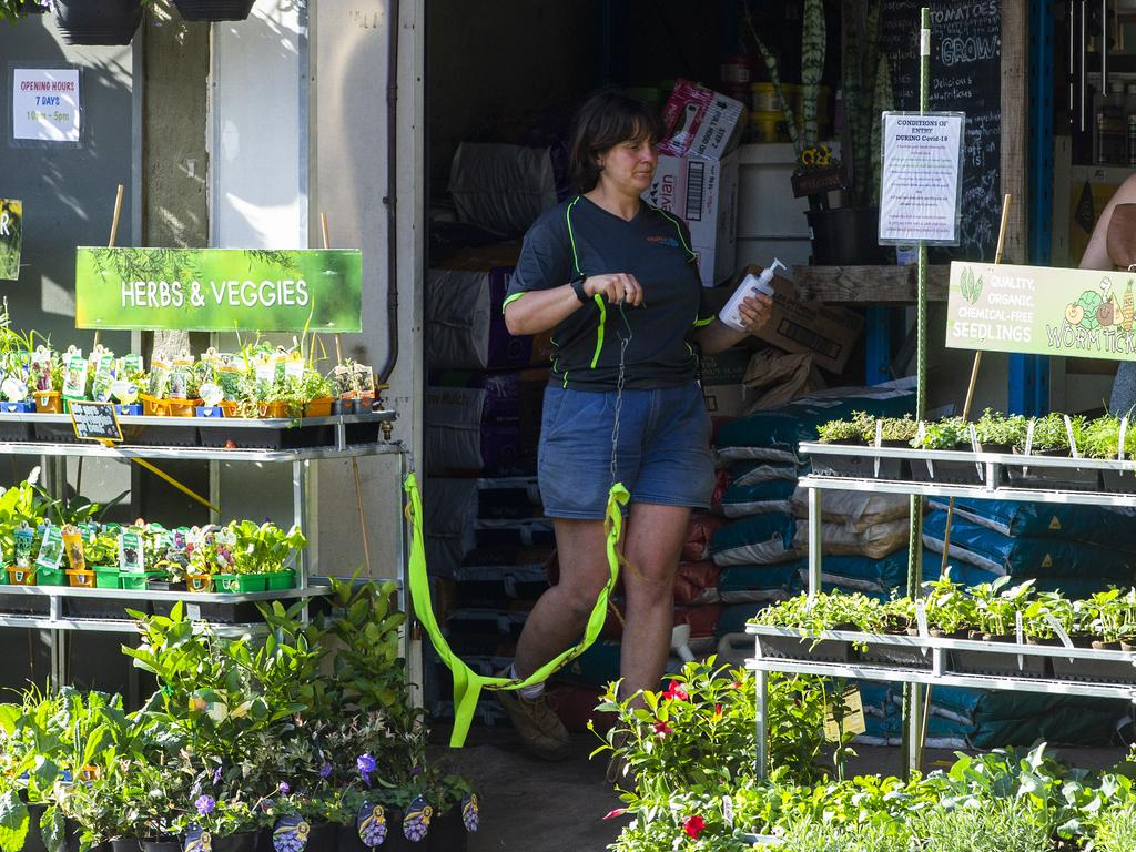 A woman at a garden centre in Sydney using hand sanitiser which is likely to become a way of life. Picture: Jenny Evans/Getty Images.