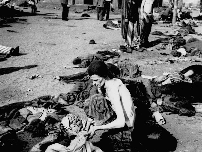 A survivor of the Bergen-Belsen concentration camp in Nazi Germany appears a living skeleton as he delouses his clothes at the camp in April 1945 soon after it was liberated by Allied troops.