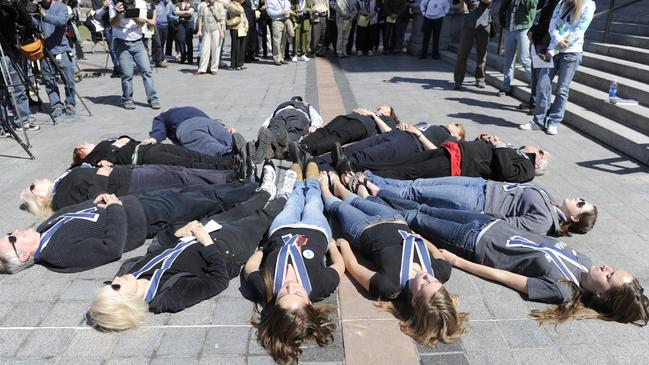 Thirteen people lay down to symbolize those killed in the Columbine school shooting at a Columbine Remembrance and Rededication on the 10th anniversary of the Columbine attack, April 20, 2009. Picture: AP