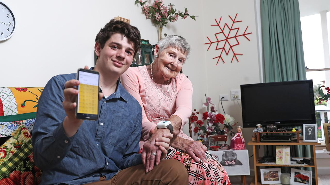Mitchell Torok and his great-grandmother, Gwen Brook, who is wearing the aWear smartwatch invention. Picture: Luke Bowden