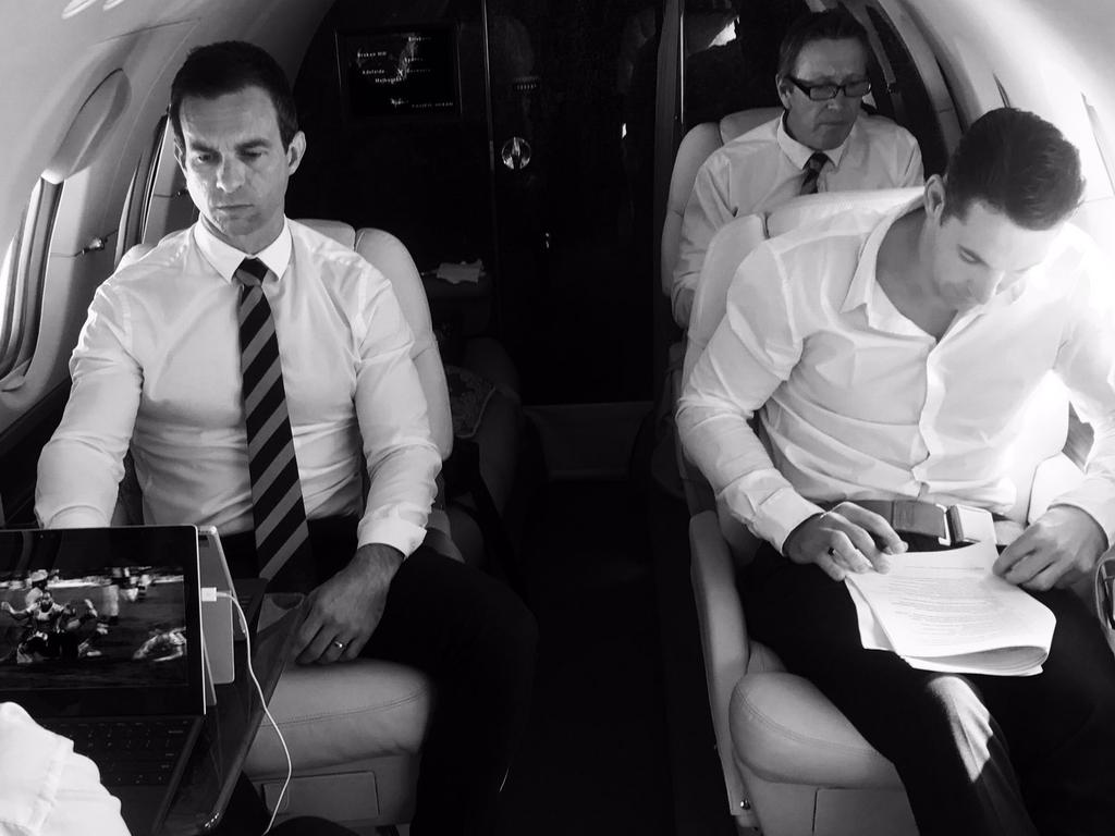 Billy Slater (right) studies his judiciary notes on the private jet ahead of the hearing on Tuesday night.