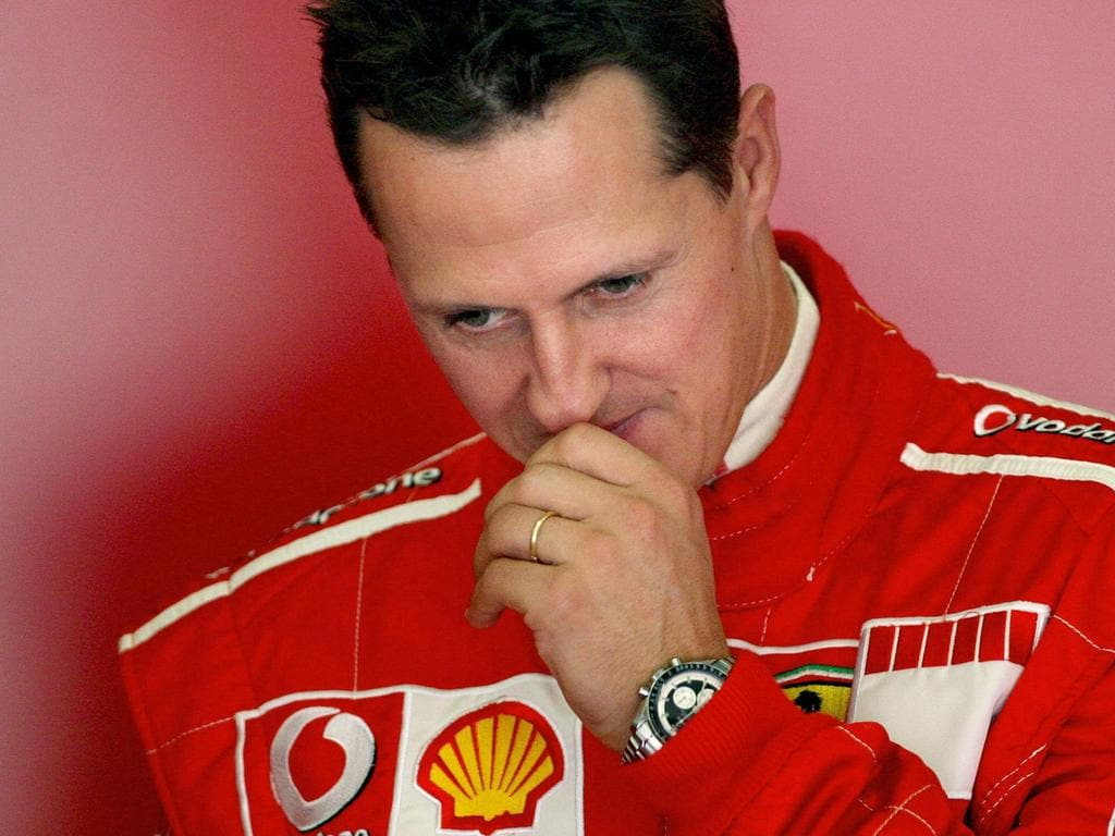 (FILES) In this file photo taken on October 12, 2006 seven-time world Formula One champion Michael Schumacher ponders during a training session at the Jerez recetrack. - Absolute reference of the Formula 1, Michael Schumacher, will turn 50 years old on January 3, 2019. The seven-time world champion was victim five years ago, on December 29, 2013 of a ski accident, leaving him in a precarious state of health. The family never wanted to communicate on the matter but according to renowned neurologists, the German pilot, technically out of the coma, might be in a vegetative state. (Photo by JOSE LUIS ROCA / AFP)