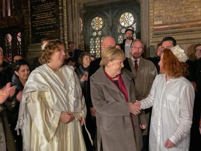 German Chancellor Angela Merkel greets member of the Jewish community at a vigil outside the New Synagogue in Berlin. Picture: AFP