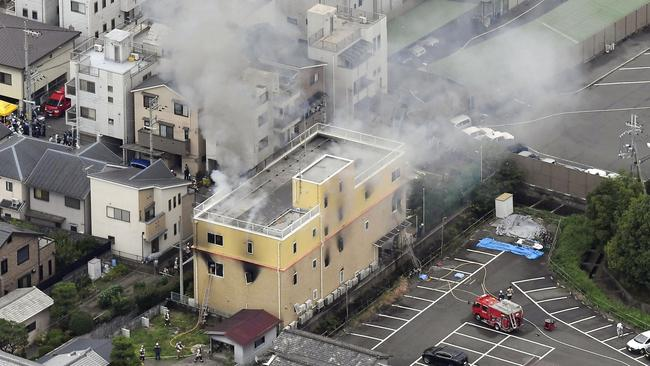 Smoke billows from the Kyoto Animation studio after the suspected arson attack. Picture: Kyodo News via AP