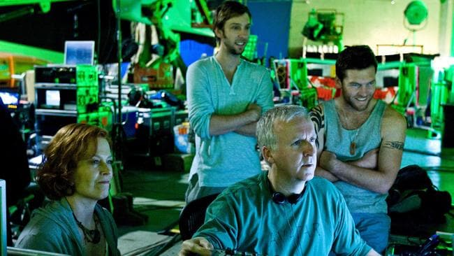 James Cameron reviews a scene with actors Sigourney Weaver, Joel David Moore and Sam Worthington during the filming of Avatar.