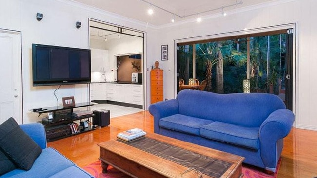 The lounge room in the house at 320 Harcourt St, Teneriffe, before it was renovated.