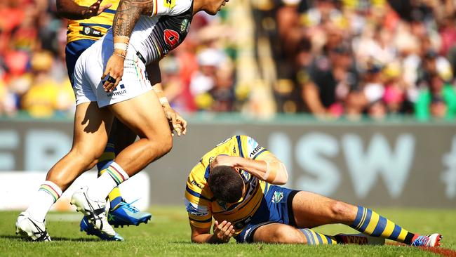 Mitchell Moses was rocked by a late hit from Moses Leota with his first kick of the game against the Panthers. Photo: Mark Kolbe