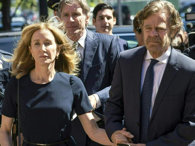 Huffman, escorted by her husband William H. Macy, makes her way to the entrance of the court. Picture: Joseph Prezioso/AFP