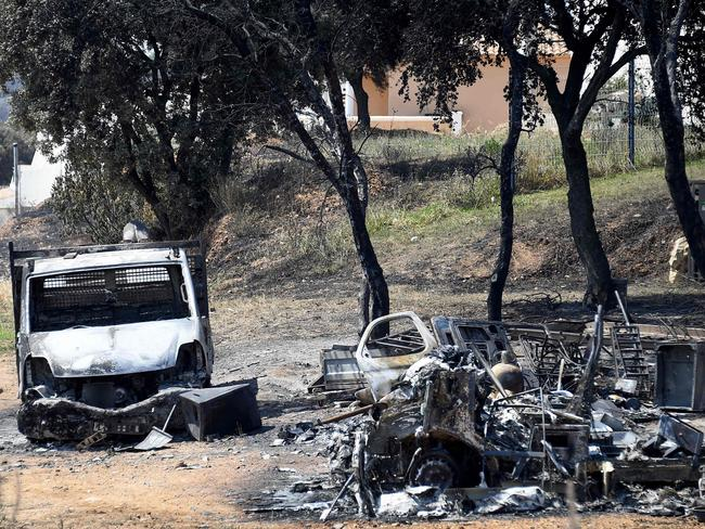 This picture taken on June 29, 2019 shows a burnt van and debris after a brushfire hit the countryside around Saint Gilles, in the south of France. Picture: AFP