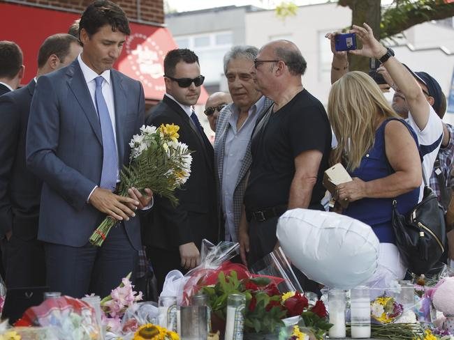 Canadian Prime Minister Justin Trudeau arrives to lay flowers in memory of Toronto shooting victims at a memorial on Danforth Ave. Picture: Getty.