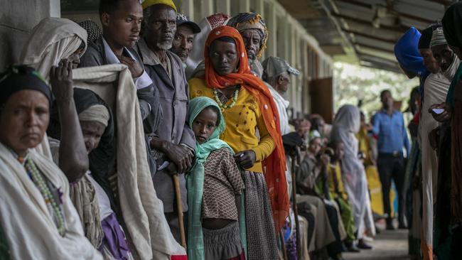 Hundreds of people wait to be assessed by medical workers to see if they have the serious eye disease trachoma. Picture: Michael Amendolia/Fred Hollows Foundation