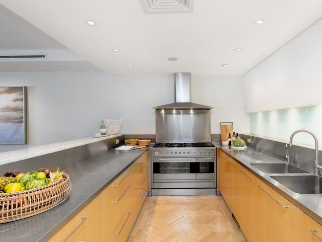 There's a stainless steel kitchen