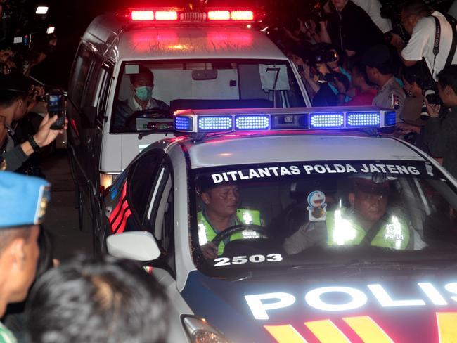 Ambulance transports one of the coffins of the executed prisoners back from Nusakambangan island.