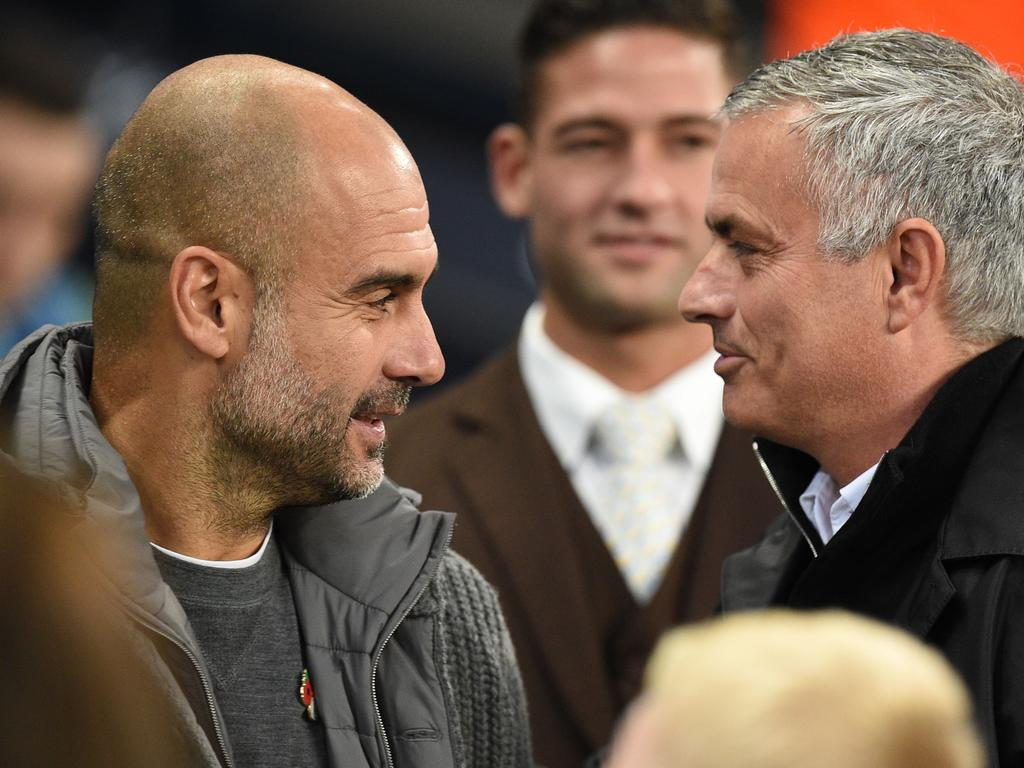 Manchester City's Spanish manager Pep Guardiola (L) greets Manchester United's Portuguese manager Jose Mourinho before the English Premier League football match between Manchester City and Manchester United at the Etihad Stadium in Manchester, north west England, on November 11, 2018. (Photo by Oli SCARFF / AFP) / RESTRICTED TO EDITORIAL USE. No use with unauthorized audio, video, data, fixture lists, club/league logos or 'live' services. Online in-match use limited to 120 images. An additional 40 images may be used in extra time. No video emulation. Social media in-match use limited to 120 images. An additional 40 images may be used in extra time. No use in betting publications, games or single club/league/player publications. /