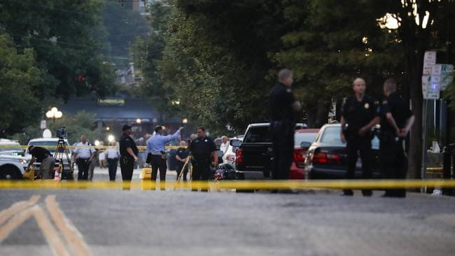 Authorities work the scene of the Dayton mass shooting.